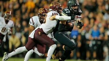 Simone makes one of his 13 tackles against Colorado (Photo by Doug Pensinger/Getty Images) By Doug Pensinger
