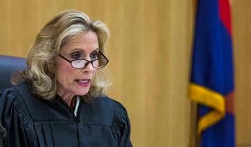 Judge Sherry Stephens presides over a hearing as Jodi Arias appears in Maricopa County Superior Court in Phoenix, Monday, September 22, 2014.  Arias is about to begin the retrial of her sentencing phase. By Mike Gertzman