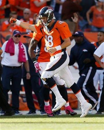 Denver Broncos quarterback Peyton Manning (18) runs upfield after a touchdown pass against the Arizona Cardinals during the second half of an NFL football game, Sunday, Oct. 5, 2014, in Denver. (AP Photo/Joe Mahoney) By Joe Mahoney