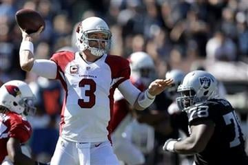 Arizona Cardinals quarterback Carson Palmer (3) passes against the Oakland Raiders during the first quarter of an NFL football game in Oakland, Calif., Sunday, Oct. 19, 2014. (AP Photo/Ben Margot) By Ben Margot