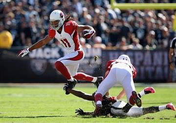 OAKLAND, CA - OCTOBER 19: Larry Fitzgerald #11 of the Arizona Cardinals leaps past a defender in the first half at O.co Coliseum on October 19, 2014 in Oakland, California.  (Photo by Ezra Shaw/Getty Images) By Ezra Shaw