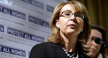 FILE - In this Oct. 22, 2014, file photo, former Arizona Rep. Gabby Giffords speaks in support of Initiative 594, a measure seeking universal background checks on gun sales and transfers in Seattle. By Jennifer Thomas