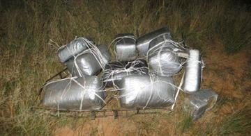 Border Patrol agents seized 185 pounds of marijuana dropped from an ultralight aircraft. By Jennifer Thomas