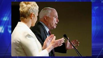 Arizona Republican Sen. John McCain speaks to the crowd as wife Cindy McCain applauds her husband at election night festivities Tuesday, Nov. 4, 2014, in Phoenix. By Jennifer Thomas