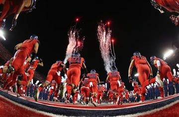 TUCSON, AZ - OCTOBER 11:  The Arizona Wildcats run out onto the field before the college football game aa\USC Trojans at Arizona Stadium on October 11, 2014 in Tucson, Arizona.  (Photo by Christian Petersen/Getty Images) By Christian Petersen