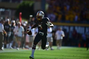 ASU safety Damarious Randall returns an interception for a touchdow. By Brad Denny