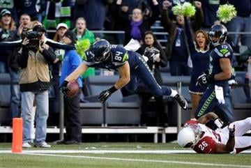 Seattle Seahawks tight end Cooper Helfet dives for a touchdown in the second half of an NFL football game against the Arizona Cardinals, Sunday, Nov. 23, 2014, in Seattle. (AP Photo/Elaine Thompson) By Elaine Thompson