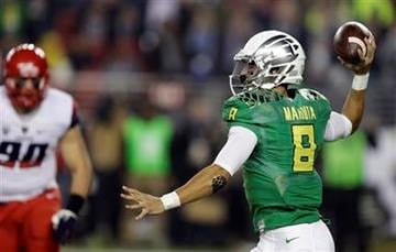 Oregon's Marcus Mariota, right, passes against Arizona during the first half of a Pac-12 Conference championship NCAA college football game Friday, Dec. 5, 2014, in Santa Clara, Calif. (AP Photo/Ben Margot) By Ben Margot