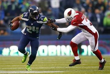 SEATTLE - DECEMBER 22:  Marshawn Lynch #24 of the Seattle Seahawks runs against Patrick Peterson #21 of the Arizona Cardinals on December 22, 2013 at CenturyLink Field in Seattle, Washington.  (Photo by Jonathan Ferrey/Getty Images) By Jonathan Ferrey