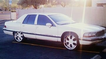 Suspects's white 1992 Buick Roadmaster. It has an Arizona license plate, number ARF6934. By Catherine Holland