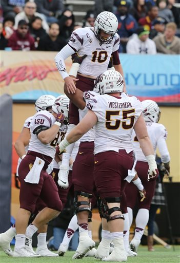 Arizona State quarterback Taylor Kelly was hoisted by teammates after scoring during the first quarter of the Sun Bowl NCAA college football game against Duke, Saturday, Dec. 27, 2014, in El Paso, Texas. (AP Photo/Victor Calzada) By Victor Calzada