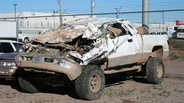 Two teenage boys died and the driver of this truck badly injured after it rolled Christmas night near Maricopa. By Catherine Holland