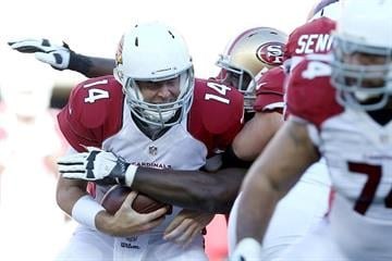 SANTA CLARA, CA - DECEMBER 28: Ryan Lindley #14 of the Arizona Cardinals is sacked in the first half against the San Francisco 49ers at Levi's Stadium on December 28, 2014 in Santa Clara, California.  (Photo by Don Feria/Getty Images) By Don Feria