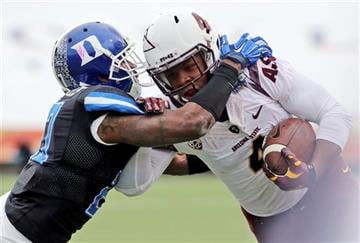 Arizona State's Demario Richard, right, tries to fend off a tackle by Duke's DeVon Edwards during the second quarter of the Sun Bowl NCAA college football game, Saturday, Dec. 27, 2014, in El Paso, Texas. (AP Photo/Victor Calzada) By Victor Calzada