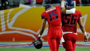 Arizona quarterback Jesse Scroggins (15) and Steven Gurrola leave the field after the Fiesta Bowl NCAA college football game against Boise State, Wednesday, Dec. 31, 2014, in Glendale, Ariz. Boise State won 38-30. By Catherine Holland