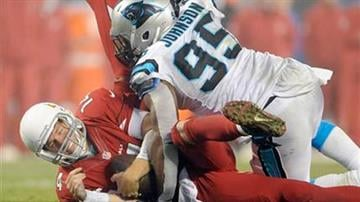 Arizona Cardinals' Ryan Lindley (14) is sacked by Carolina Panthers' Charles Johnson (95) in the second half of an NFL wild card playoff football game in Charlotte, N.C., Saturday, Jan. 3, 2015. The Panthers won 27-16. By Mike Gertzman