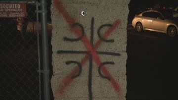 """Vandals painted a cross with four Cs, which is on the Serbian coat of arms and means """"Only unity saves the Serbs,"""" and then put a red X across it. By Jennifer Thomas"""