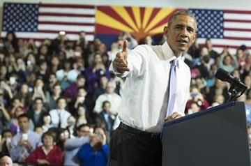 US President Barack Obama speaks about home purchases and refinancing at Central High School in Phoenix, Arizona, January 8, 2015. AFP PHOTO / SAUL LOEB        (Photo credit should read SAUL LOEB/AFP/Getty Images) By SAUL LOEB