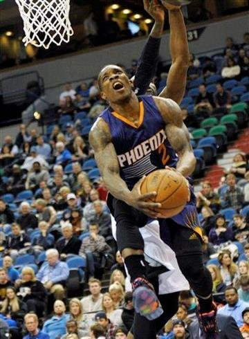 Phoenix Suns' Eric Bledsoe lays up a shot in the first quarter of an NBA basketball game against the Minnesota Timberwolves, Wednesday, Jan. 7, 2015, in Minneapolis. (AP Photo/Jim Mone) By Jim Mone