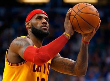 ORLANDO, FL - DECEMBER 26:  Cleveland Cavaliers forward LeBron James #23 attempts a free throw during the game against the Orlando Magic at Amway Center on December 26, 2014 in Orlando, Florida.  (Photo by Sam Greenwood/Getty Images) By Sam Greenwood