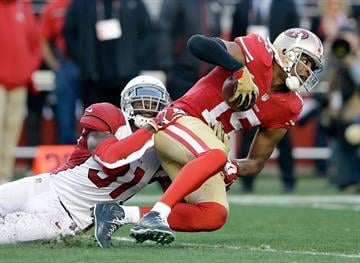 SANTA CLARA, CA - DECEMBER 28:  Michael Crabtree #15 of the San Francisco 49ers is tackled by Antonio Cromartie #31 of the Arizona Cardinals at Levi's Stadium on December 28, 2014 in Santa Clara, California.  (Photo by Ezra Shaw/Getty Images) By Ezra Shaw