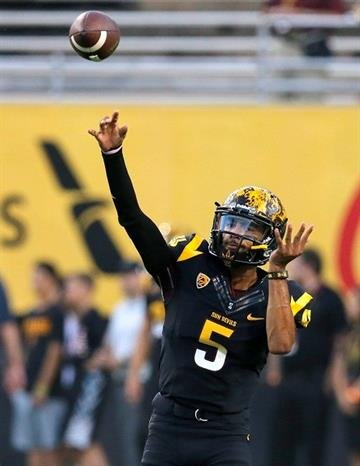 Arizona State quarterback Manny Wilkins (5) during the first half of an NCAA college football game against UCLA, Thursday, Sept. 25, 2014, in Tempe, Ariz. (AP Photo/Rick Scuteri) By Rick Scuteri