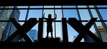Diego Santa Cruz, 8, from Phoenix, poses for a photo in a set of Roman numerals at the Super Bowl XLIX NFL Experience Saturday, Jan. 24, 2015, in Phoenix. (AP Photo/Charlie Riedel) By Charlie Riedel