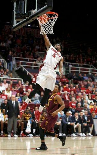 Stanford guard Chasson Randle (5) dunks against Arizona State guard Tra Holder (0) during the first half of an NCAA college basketball game Saturday, Jan. 24, 2015, in Stanford, Calif. (AP Photo/Tony Avelar) By Tony Avelar