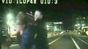 The arrest was caught on a dash-cam video on May 20, 2014. By Catherine Holland