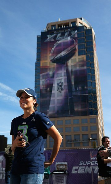 PHOENIX, AZ - JANUARY 28: A Seattle Seahawks fan has her photo taken in a fan zone for the upcoming Super Bowl XLIX between Seahawks and New England Patriots on January 28, 2015 in Phoenix, Arizona.  (Photo by Justin Heiman/Getty Images) By Justin Heiman