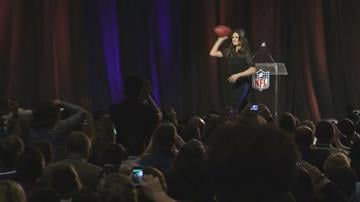 Idina Menzel tossed a football during a pregame news conference for NFL Super Bowl XLIX on Thursday, Jan. 29, 2015. By Jennifer Thomas