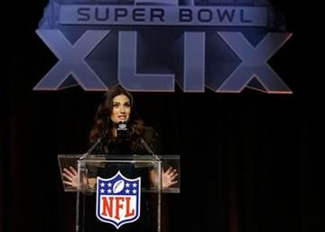 Idina Menzel answers questions at a pregame news conference for NFL Super Bowl XLIX football game Thursday, Jan. 29, 2015, in Phoenix. Menzel is scheduled to sing the national anthem. By Jennifer Thomas