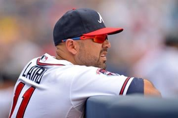 ATLANTA, GA - JUNE 18:  Gerald Laird #11 of the Atlanta Braves in the dugout against the Philadelphia Phillies at Turner Field on June 18, 2014 in Atlanta, Georgia. (Photo by Kevin Liles/Getty Images) By Kevin Liles