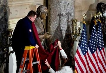 U.S. Capitol workers cover the statue of the late Barry Goldwater after the dedication ceremony at the National Statuary Hall of the United States Capitol in Washington, Wednesday, Feb. 11, 2015.   (AP Photo/Manuel Balce Ceneta) By Manuel Balce Ceneta