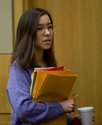 Jodi Arias leaves the courtroom at Maricopa County Superior Court in Phoenix on Thursday, February 12, 2015. Arias was found guilty of first-degree murder in the death of former boyfriend, Travis Alexander, but the jury was hung on the penalty phase.