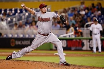 MIAMI, FL - AUGUST 15: Addison Reed #43 of the Arizona Diamondbacks pitches during the ninth inning of the game against the Miami Marlins at Marlins Park on August 15, 2014 in Miami, Florida.  (Photo by Rob Foldy/Getty Images) By Rob Foldy