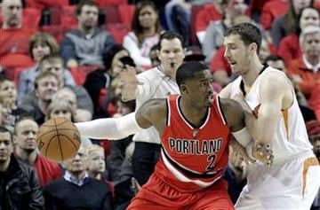 Portland Trail Blazers guard Wesley Matthews, left, works the ball in against Phoenix Suns guard Goran Dragic, from Slovenia, during the first half of an NBA basketball game in Portland, Ore., Thursday, Feb. 5, 2015. (AP Photo/Don Ryan) By Don Ryan
