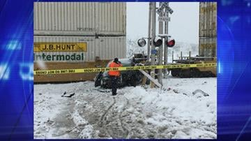 A train hit a vehicle that was stuck on the tracks in Flagstaff. By Jennifer Thomas