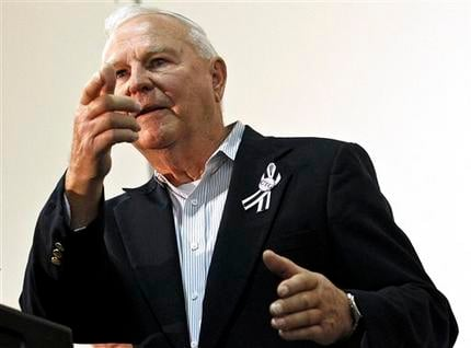 FILE - In this Nov. 8, 2012, file photo, Bill Badger points his hand in the shape of a gun as he describes the events of the day Jared Loughner killed six people and wounded 13 others.