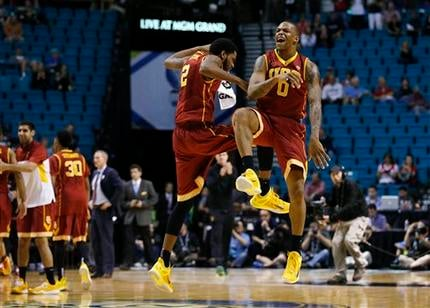 Southern California's Malik Martin, left, and Darion Clark celebrate after their team took the lead over Arizona State near the end an NCAA college basketball game in the first round of the Pac-12 ournament Wednesday, March 11, 2015, in Las Vegas