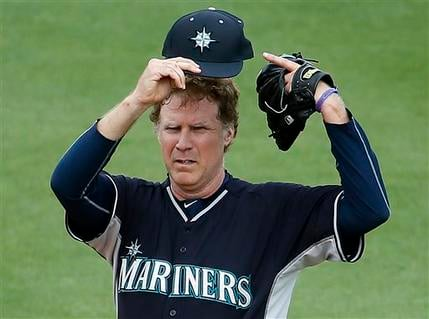 Actor Will Ferrell shows off his cap as he plays second base for the Seattle Mariners during the second inning of a spring training baseball game against the Oakland Athletics, Thursday, March 12, 2015, in Mesa, Ariz. The comedian plans to play every posi