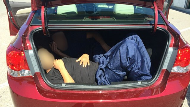 Chevrolet Cruze with two individuals in the trunk (Source: Customs and Border Protection)