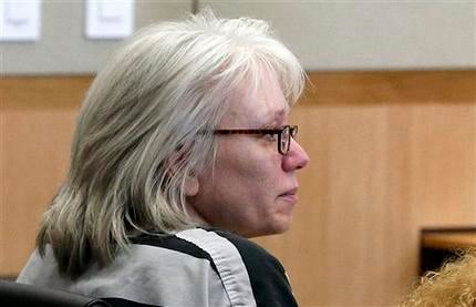 In this Aug. 1, 2013, file photo, Debra Jean Milke listens to a judge during a hearing at Maricopa County Superior Court in Phoenix. (Source: AP Photo/Ross D. Franklin, Pool, File)