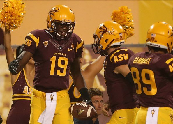 Ellis Jefferson celebrates with quarterback Mike Bercovici after scoring a touchdown (