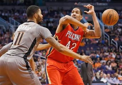 New Orleans Pelicans' Alexis Ajinca (42), of France, has the ball knocked loose by Phoenix Suns' Markieff Morris (11) during the first half of an NBA basketball game, Thursday, March 19, 2015, in Phoenix. (AP Photo/Matt York)