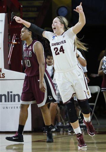 Arizona State forward Kelsey Moos (24) celebrates near Arkansas Little Rock forward Kaitlyn Pratt (40) after a women's second round NCAA tournament college basketball game Monday, March 23, 2015, Tempe, Ariz. Arizona State won 57-54. (AP Photo/Matt York)