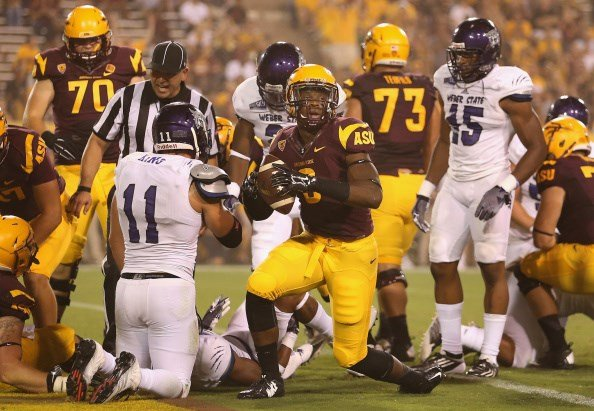 Ballage scores his first career TD in the 2014 season opener against Weber State (Getty Images)