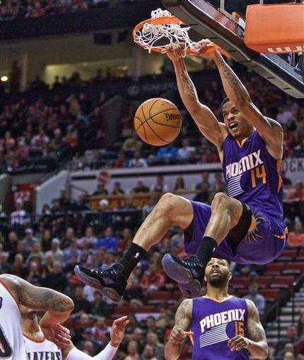 Phoenix Suns guard Gerald Green dunks against the Portland Trail Blazers during the second quarter of an NBA basketball game in Portland, Ore., Monday, March 30, 2015. (Source: AP Photo/Craig Mitchelldyer)