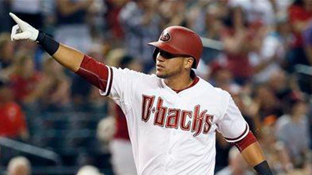 Arizona Diamondbacks' David Peralta points to the stands after hitting a three-run home run during the third inning of a MLB baseball game against the San Francisco Giants, Tuesday, April 7, 2015, in Phoenix. (Source: AP Photo/Matt York)