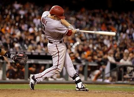 Arizona Diamondbacks' Aaron Hill swings for a two run double off San Francisco Giants' Sergio Romo in the 12th inning of a baseball game Thursday, April 16, 2015, in San Francisco. (AP Photo/Ben Margot)